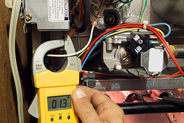 Residential Heating: Repairs & Furnace Installation | Hutchens Company - residential-heating-meter-check
